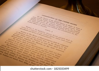 New Brunswick, NJ - September 20, 2020: Open book shows selective shallow focus on the Preamble and Article 1 of the Constitution of the United States of America