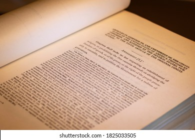 """New Brunswick, NJ - September 20, 2020: Open book shows selective shallow focus on the First Amendment to the Constitution of the United States of America, commonly known as the """"Freedom of Speech"""""""