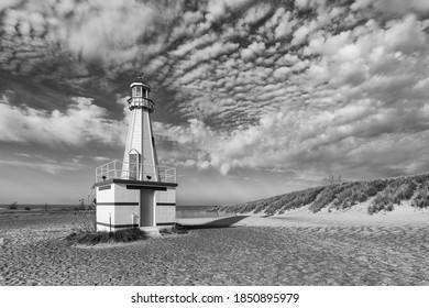 NEW BUFFALO, MICHIGAN, USA - NOVEMBER 5, 2020: New Buffalo lighthouse and beach under cloudy sky