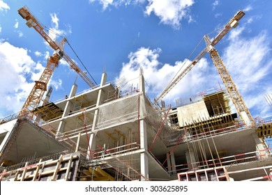 A new building is being constructed with use of tower crane.