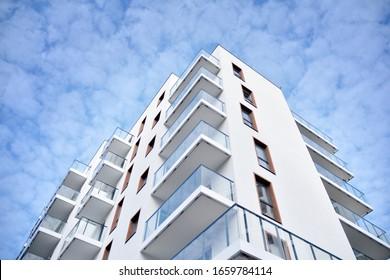 New building condominium. Modern apartment complex exterior.