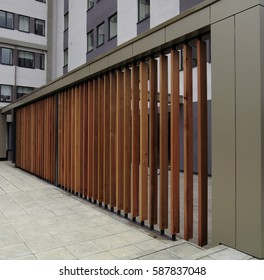 A New Building Fence Barrier to Obscure Exterior Objects with Angled Wooden Venting Slats