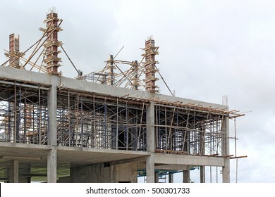 new building under construction with brick work and wooden scaffolding