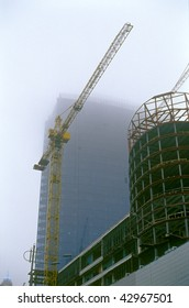 New buildings under construction with two cranes.