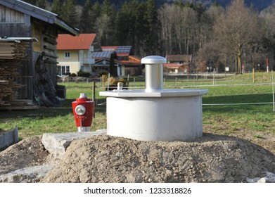 New built Stainless-Steel-Tapping (Well) of a Spring for the local Water Supply in rural Environment, Bavaria, Germany