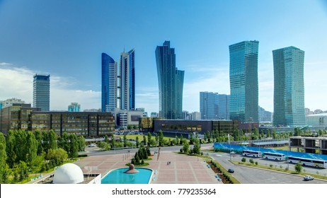 New business district with traffic on road and fountain from mosque roof in the capital of Kazakhstan in Astana.