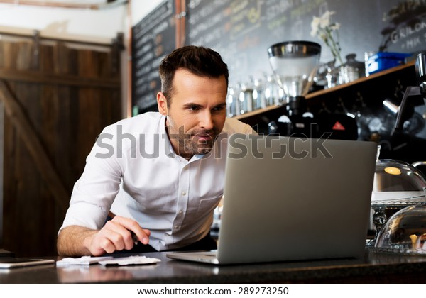 New business owner counting revenue