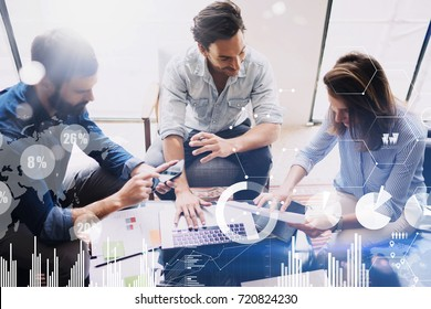 New business project startup.Group of young coworkers discussing ideas in modern office.Concept of digital diagram,graph interfaces,virtual screen,connections icon on blurred background.Top view