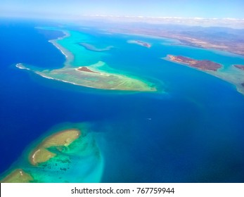 New Caledonia island with blue see view from airplane window