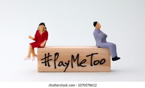 Woodenblockwritten#PayMeToo. A new campaign to fill the wage gap between men and women.