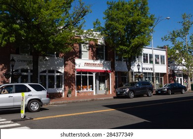 New Canaan, CT, USA - May 24, 2015: Daytime view of a street in the downtown area of New Canaan, Connecticut on May 24, 2015 during the summer season