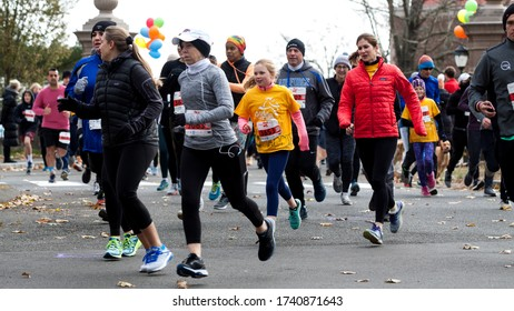 """New Canaan, CT, USA - November 17, 2019: People from the town gather for the annual """"Turkey Trot"""". The event is a 5K walk, run or jog at the WAVENY PARK. All proceeds benefit the Open Doors shelter."""