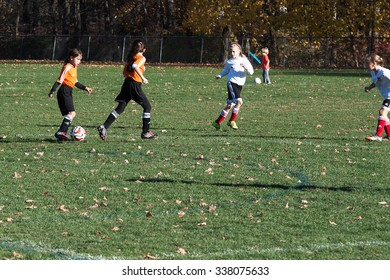 New Canaan, CT, USA - November 8, 2015: Daytime scene of young girls in an all girls team in New Canaan, Connecticut on November 8, 2015, while playing an organized youth soccer game