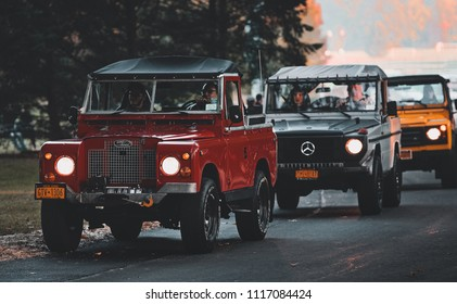 New Canaan, CT / USA – October 16th 2016: Caffeine and Carburetors, Land Rovers and Mercedes G Wagon driving through Waveny Park.