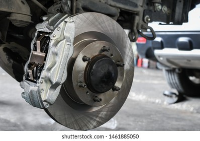 New car brake system replacement, brake disc, brake caliper.