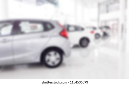 New car at car dealership and showroom of shallow office depth