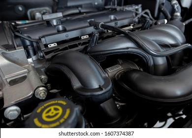 New car engine. Car hood open. Automotive industry.