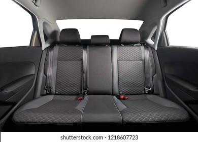 New car inside. Clean car interior. Black back seats in sedan. Car cleaning theme.
