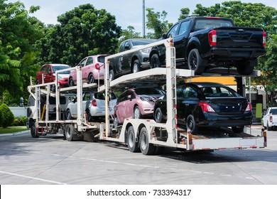 new car on big trailer, delivery shipment of transportation.
