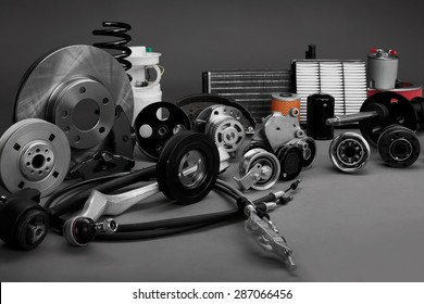New car parts on a gray background closeup. Shop for auto. The composition of the new auto parts