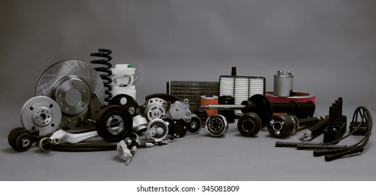 New car parts on a gray background closeup. Large range of new car parts service station