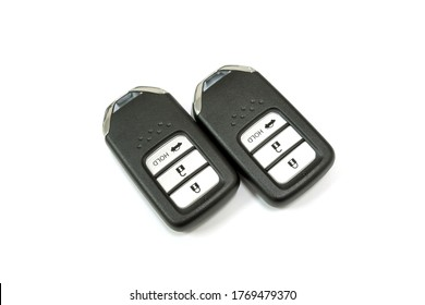 New car wave key with remote control on white background, isolated.