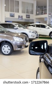 New cars at dealer showroom. Themed blur background with bokeh effect.