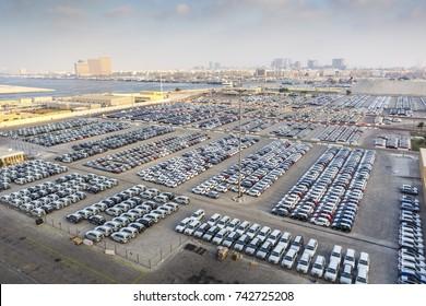 New cars ready to ship in the port Rashid in Dubai, UAE