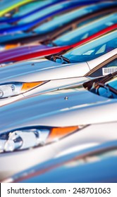 New Cars Stock in Row. Modern Compact Cars Dealership Parking Lot Closeup.