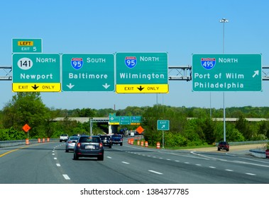 New Castle, Delaware, U.S.A - April 26, 2019 - Traffic on 295 South with a route to Interstate 95 North, 95 South, 141 North and 495 North