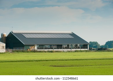 new cattle barn with solar panels on the roof
