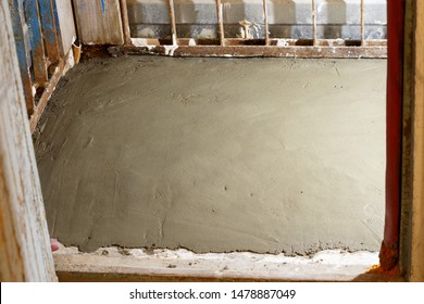 New cement floor on the loggia. Drying mortar from a sand-cement mixture.