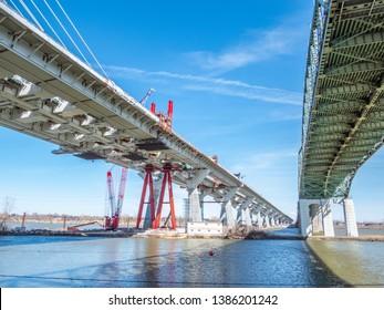 New Champlain Bridge (Samuel de Champlain) next to the Old Champlain Bridge in Montreal, Quebec, Canada on Saint Lawrence River.
