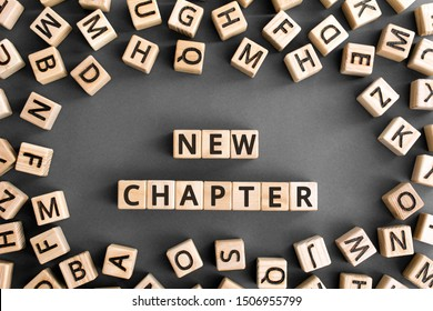 new chapter - words from wooden blocks with letters, starting new life new chapter concept, random letters around, grey background