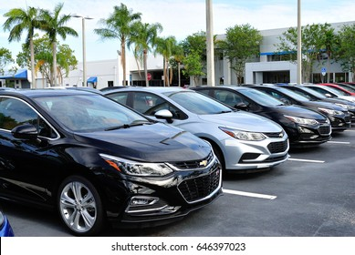 New Chevrolet Cruze lined up on the lot ready to be sold.   Grieco Chevrolet Fort Lauderdale Florida May 23 2017.  Chevrolet is a division of General Motors Corp