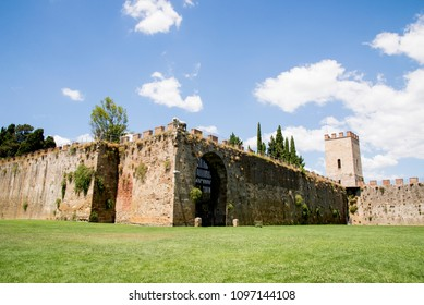 New city walls, erected in 1156 by Consul Cocco Griffi. Field of Miracles Campo dei Miracoli next to the walls behind the Baptistery of St. John Battistero in Pisa, Tuscany, Italy. Travel Destination