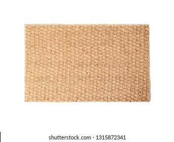 New clean doormat on white background, top view
