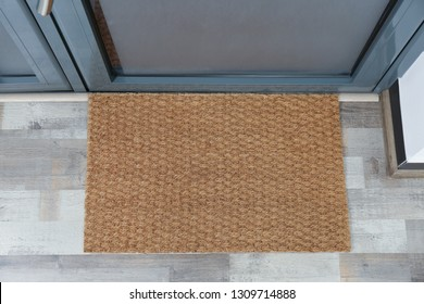 New clean mat near entrance door, top view