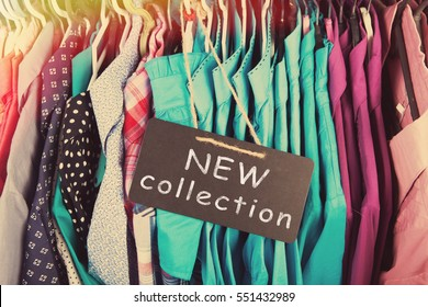 New collection clothes hanging on the rack in the fashion store