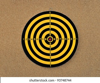 New Colorful Dart board with score numbers isolated on cork board background