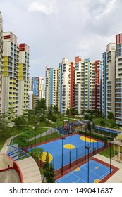 A new colorful neighborhood estate with carpark and playground.