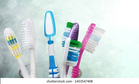 New Colorful Toothbrushes in A Glass  on  Background