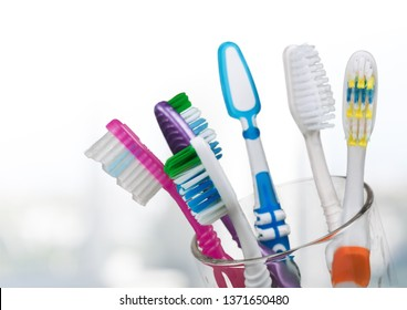 New Colorful Toothbrushes on light Background