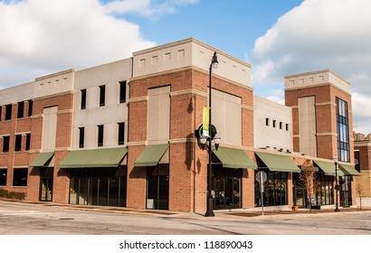 New Commercial, Retail and Office Space available for sale or lease in generic red brick office building with awning