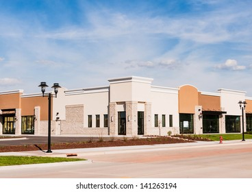 New Commercial, Retail and Office Space available for sale or lease. Strip Mall. Modern commercial office building.