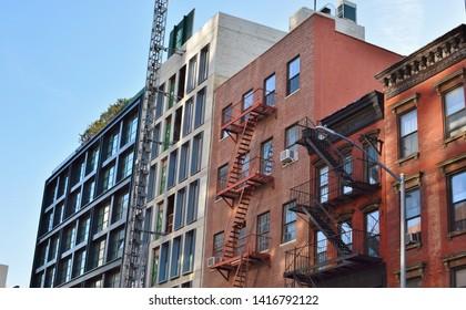 New Condo Development Bowery Street New York City Gentrification of Old Neighborhood Immigrant Tenement Apartments