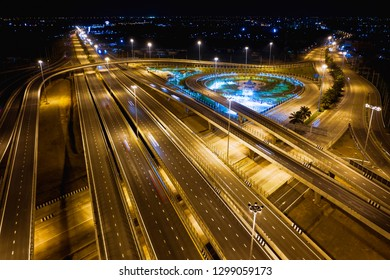 new construction expressway and ring road industry connections the city for transportation and logistics business in Thailand at night long exposure shot over lighting and movement car headlights