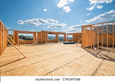 A new construction home being framed on a hillside with a view overlooking Spokane Valley, Washington