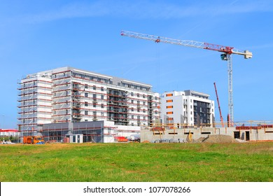 New construction site with cranes. Developer's project on green field.