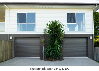 New contemporary double storey house with double garage roller doors